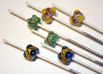 Finished glass beads on mandrels